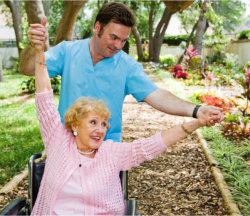 Caregiver assisting his patient to have an exercise
