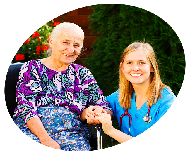 Old woman and her caregiver holding hands and smiling